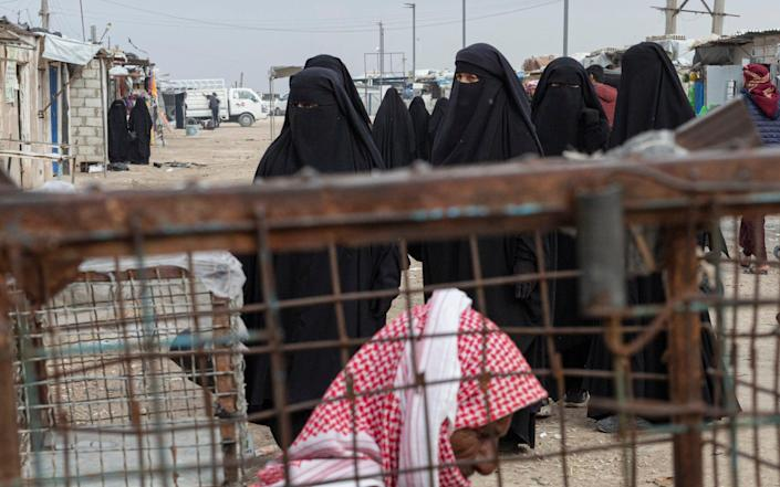 Women living in Al-Hol camp in northeast Syria have used contraband mobile phones to find love online - Sam Tarling for The Telegraph