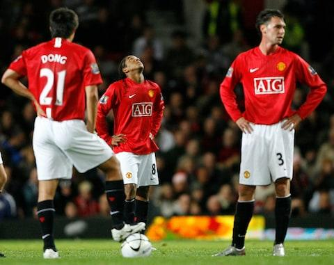 Anderson, Dong Fangzhuo (left) and Chris Eagles (right) contemplate the coming hairdryer after Coventry score in 2007 - Credit: DARREN STAPLES/REUTERS