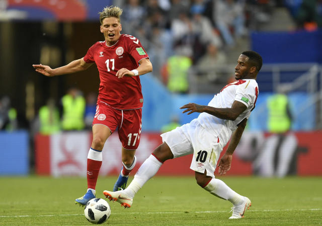 Denmark's LARSEN Jens Stryger, left, duels for the ball with Peru's Jefferson Farfan during the group C match between Peru and Denmark at the 2018 soccer World Cup in the Mordovia Arena in Saransk, Russia, Saturday, June 16, 2018. (AP Photo/Martin Meissner)