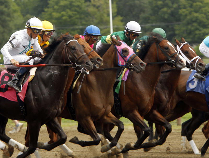 FILE - In this Aug. 21, 2010 file photo, horses start the fifth race at Saratoga Race Course in Saratoga Springs, N.Y. Saratoga Springs' racetrack is still going strong as it marks its 150th anniversary this summer, the centerpiece attraction in a town that's also known for mineral springs, Victorian charm and upscale hotels, shops and restaurants.  (AP Photo/Mike Groll, File)