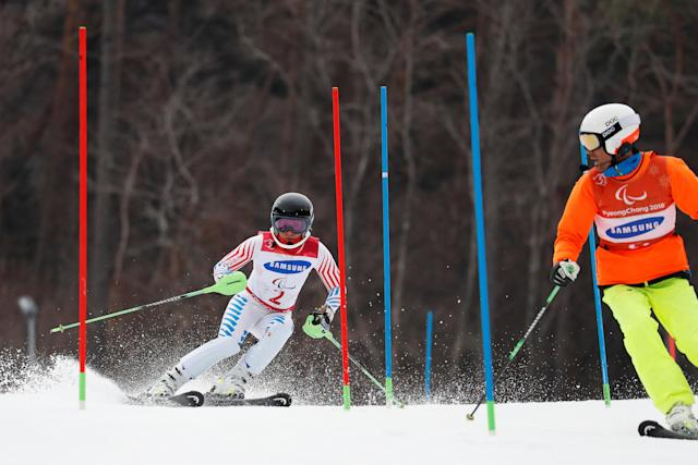 Alpine Skiing - Pyeongchang 2018 Winter Paralympics - Women's Slalom - Visually Impaired - Run 1 - Jeongseon Alpine Centre - Jeongseon, South Korea - March 18, 2018 - Danelle Umstead of the U.S. and her guide. REUTERS/Paul Hanna