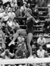 <p>Larissa Latynina defends her gold medal title at the 1960 Rome Olympics. (Photo by von der Becke/ullstein bild via Getty Images) </p>