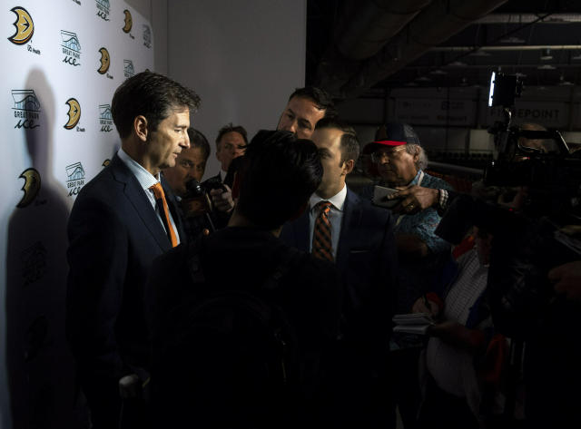 New Anaheim Ducks head coach Dallas Eakins, left, talks to the media following an NHL hockey news conference in Irvine, Calif., Monday, June 17, 2019. (Paul Bersebach/The Orange County Register via AP)