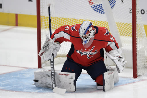 Washington Capitals goaltender Vitek Vanecek (41) stops the puck during the first period of an NHL hockey game against the Buffalo Sabres, Friday, Jan. 22, 2021, in Washington. (AP Photo/Nick Wass)