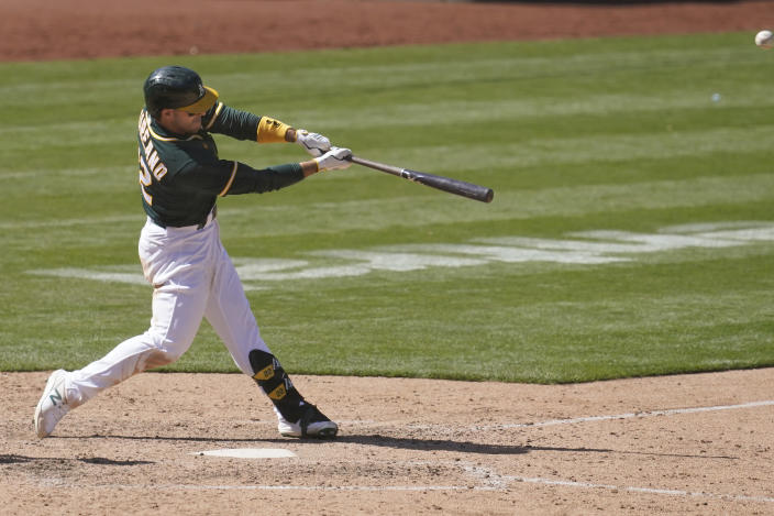Oakland Athletics' Ramon Laureano hits a two-run home run against the Baltimore Orioles during the eighth inning of a baseball game in Oakland, Calif., Sunday, May 2, 2021. (AP Photo/Jeff Chiu)