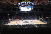 A few basketball fans watch as Creighton takes on St. John's in an NCAA college basketball game in the quarterfinals of the Big East Conference tournament, Thursday, March 12, 2020, at Madison Square Garden in New York. (AP Photo/Mary Altaffer)