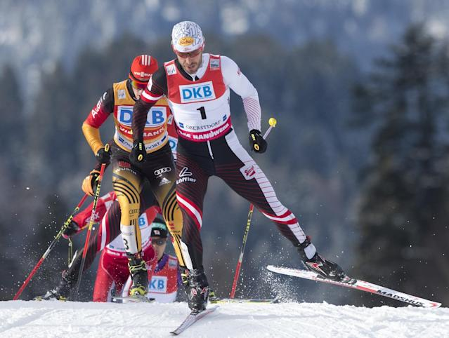 Christoph Bieler of Austria, front, skis during the individual Gundersen competition at the Nordic Combined FIS World Cup in Oberstdorf, southern Germany, Sunday, Jan. 26, 2014. Bieler placed fourth. (AP Photo/Jens Meyer)