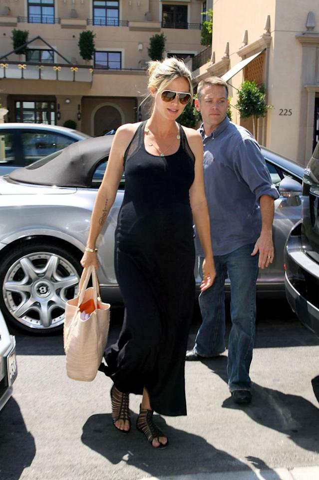 """If you're looking for a more practical gift to give someone, Heidi Klum has <a href=""""http://omg.yahoo.com/news/heidi-klum-gets-nude-except-for-some-socks-for-coffee-table-book/27296"""" target=""""_blank"""">a new coffee-table book on the way called """"Heidilicious.""""</a> """"I've been shooting with this photographer, Rankin, for seven years, and ... he always gets me to take my clothes off,"""" she told Access Hollywood this week. Anthony/Nathanael Jones/<a href=""""http://www.pacificcoastnews.com/"""" target=""""new"""">PacificCoastNews.com</a> - August 31, 2009"""
