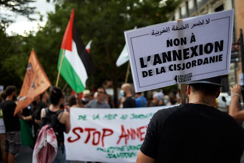 The placard reads 'No to the West Bank annexion'. Supporters of Palestine organized a gathering in Toulouse against the planned annexion of parts of West Bank and the total annexion of the Jordan Valley by Netanyahu governement on July 1st 2020. Netanyahu said he follows the Trump-Kushner peace plan in Israel/Palestine. However, most of UN's countries oppose the move on legal ground.Sympathizers of Palestine promote also the BDS (Boycot, Desinvest, Sanction) movement which is legal in France since a decision of the European Justice Court. Toulouse. France. July 1st 2020. (Photo by Alain Pitton/NurPhoto via Getty Images)