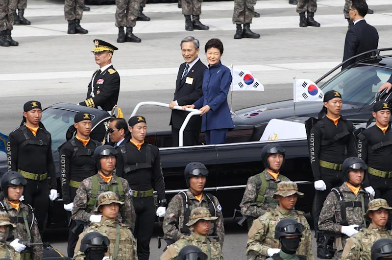 South Korean President Park Geun-hye, center right, and Defense Minister Kim Kwan-jin, center left, inspect troops during the 65th anniversary of the Armed Forces Day ceremony at Seoul military airport in Seongnam, South Korea, Tuesday, Oct. 1, 2013. (AP Photo/Ahn Young-joon)