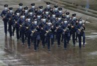 "Hong Kong police show their new goose step marching style on the National Security Education Day at a police school in Hong Kong Thursday, April 15, 2021. Authorities in Hong Kong are marking the day with a police college open house, where police personnel demonstrated the Chinese military's ""goose step"" march, replacing British-style foot drills. The ""goose step"" march is one in which troops swing their legs off the ground in unison, keeping each leg straight.(AP Photo/Vincent Yu)"