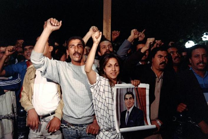 Supporters of Ben Ali demonstrate in Tunis in November 1987 following his swearing-in as president, replacing Habib Bourguiba (AFP Photo/JOEL ROBINE)