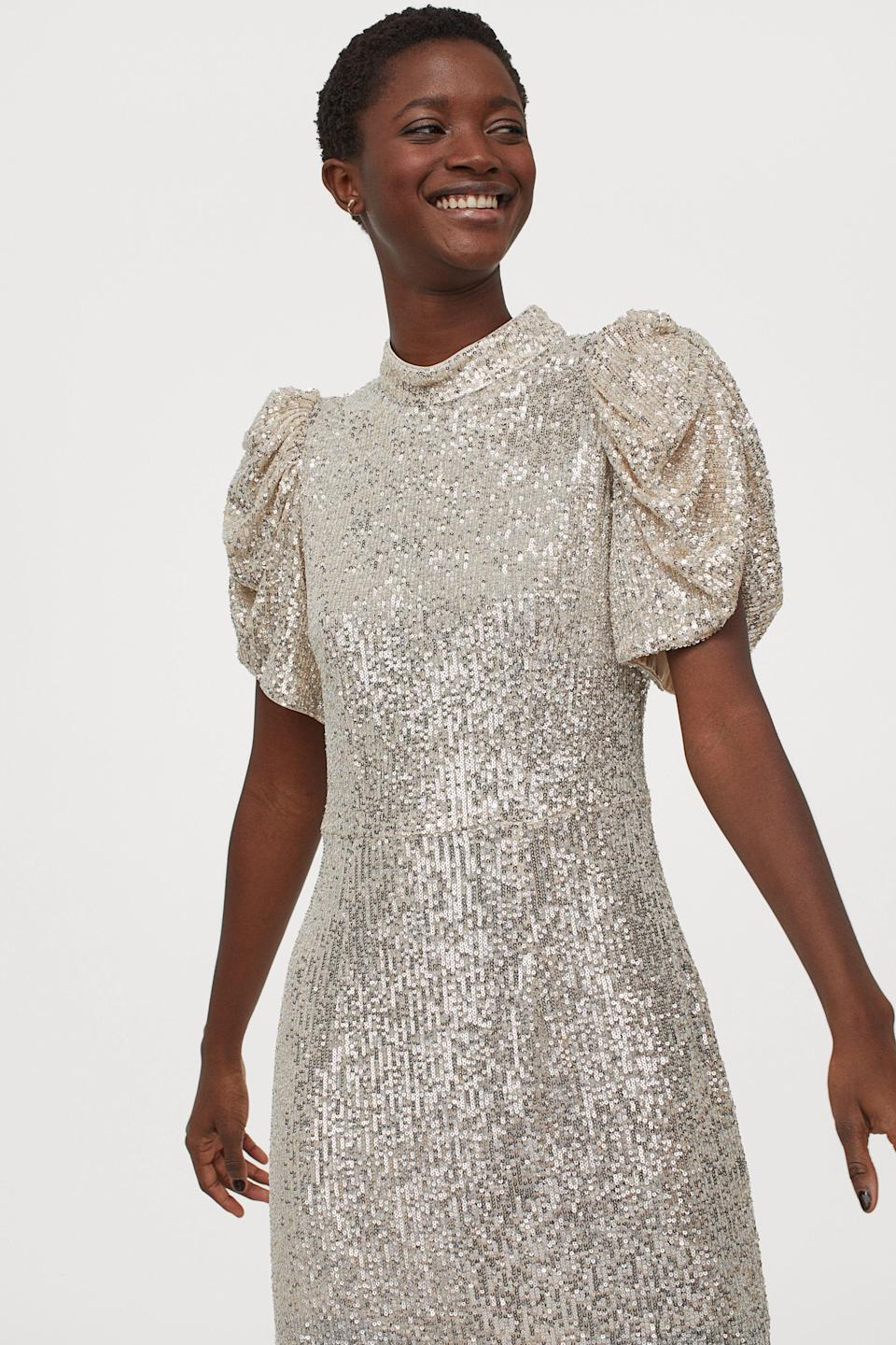 """<p><strong>H&M</strong></p><p>hm.com</p><p><strong>$49.99</strong></p><p><a href=""""https://go.redirectingat.com?id=74968X1596630&url=https%3A%2F%2Fwww2.hm.com%2Fen_us%2Fproductpage.0931093001.html&sref=https%3A%2F%2Fwww.goodhousekeeping.com%2Fbeauty%2Ffashion%2Fg25400387%2Fnew-years-eve-outfits%2F"""" rel=""""nofollow noopener"""" target=""""_blank"""" data-ylk=""""slk:Shop Now"""" class=""""link rapid-noclick-resp"""">Shop Now</a></p><p>This dress has everything you'd want for NYE: puff sleeves, sequins, and a standup collar. </p>"""