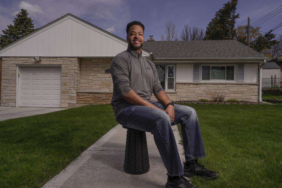 Chris Alexander poses for a picture outside his Wauwatosa, Wis., home on April 23, 2021. (AP Photo/Morry Gash)
