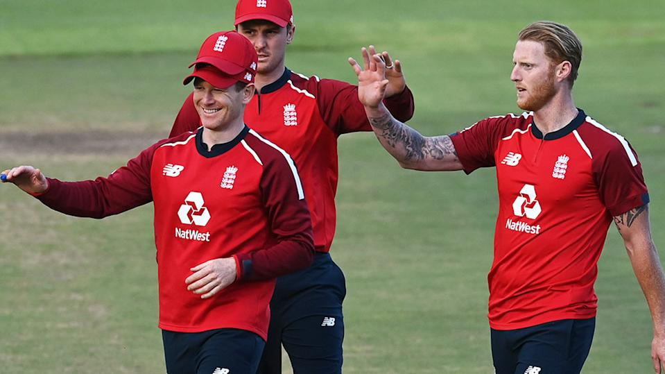 Eoin Morgan and England teammates, pictured here celebrating a wicket against South Africa.