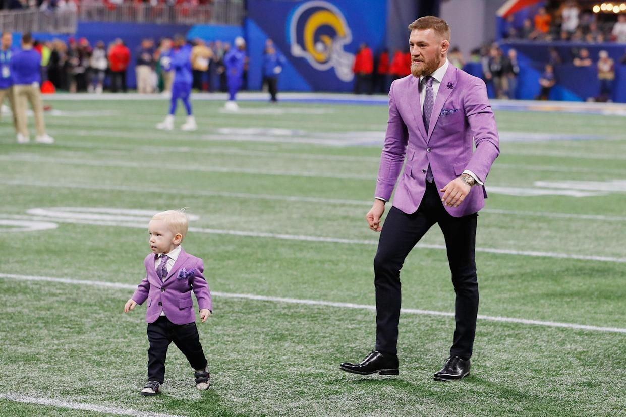 conor mcgregor and his son on the super bowl field