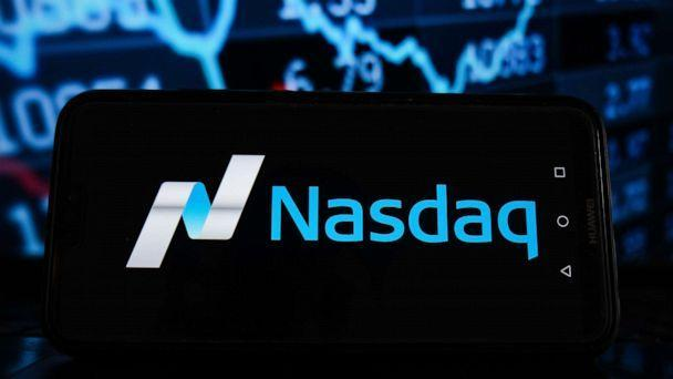 PHOTO: The Nasdaq logo is displayed on a smartphone with stock market percentages in the background in a Photo Illustration. (LightRocket via Getty Images)