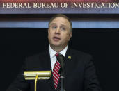 Special Agent in Charge Aaron Rouse of the FBI Las Vegas Field Office speaks during a news conference at the FBI Las Vegas Field Office, Wednesday, July 14, 2021, in Las Vegas. U.S. officials declared they dismantled a key international cocaine and money-laundering hub in an ongoing investigation that began in Las Vegas and has involved at least 30 other countries. The top federal prosecutor and FBI chief in Las Vegas said the recent arrests of six people in Nevada, Arizona, California and Washington state came as part of the six-year probe. (Bizuayehu Tesfaye/Las Vegas Review-Journal via AP)