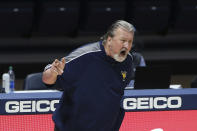 West Virginia coach Bob Huggins reacts during the second half of an NCAA college basketball game against Oklahoma State Saturday, March 6, 2021, in Morgantown, W.Va. (AP Photo/Kathleen Batten)