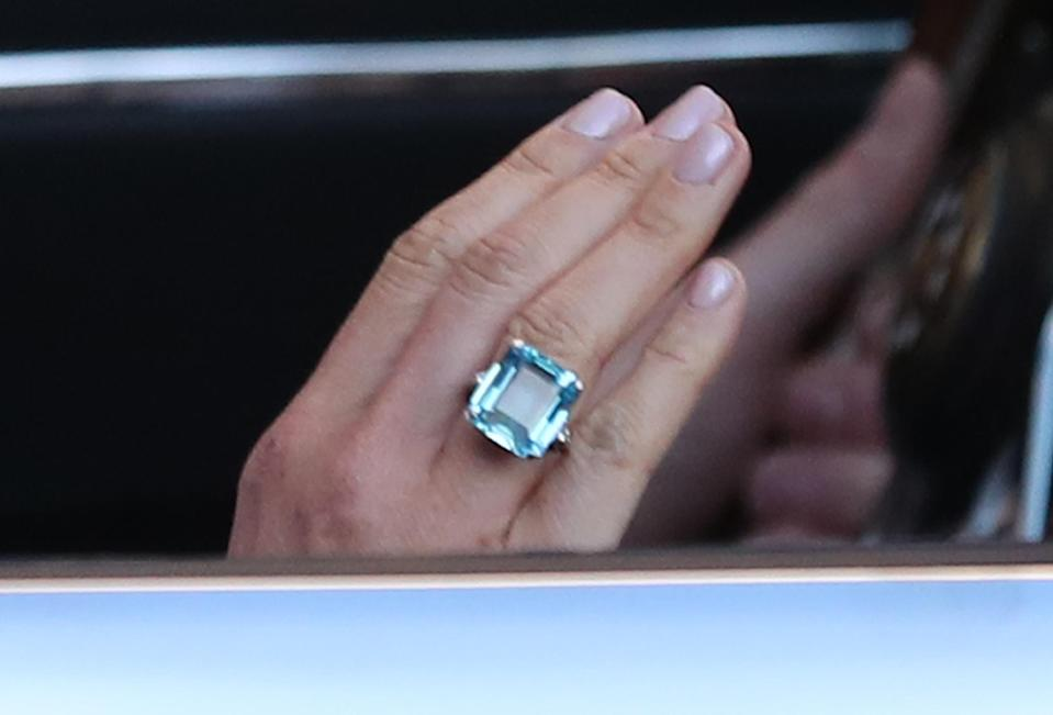 Meghan showed off the ring as she waved to onlookers. [Photo: PA]