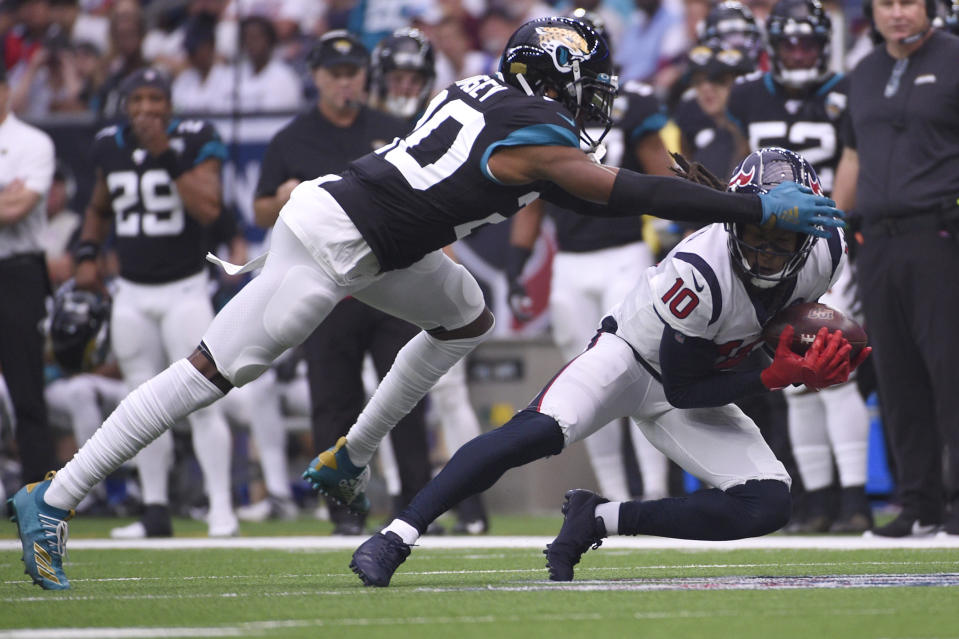 Houston Texans wide receiver DeAndre Hopkins (10) makes a catch in front of Jacksonville Jaguars cornerback Jalen Ramsey (20) during the first half of an NFL football game Sunday, Sept. 15, 2019, in Houston. (AP Photo/Eric Christian Smith)