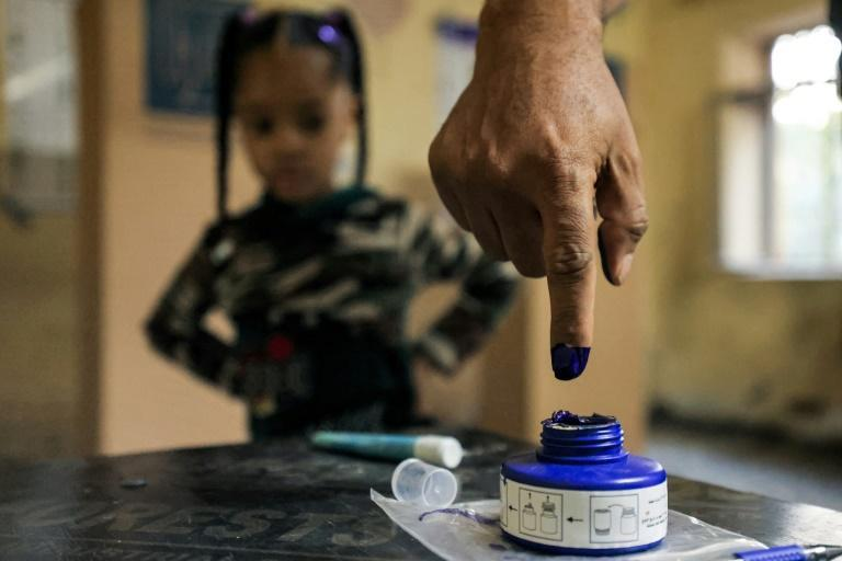 A man dips his finger in ink after voting at a polling station in Iraq's capital Baghdad (AFP/AHMAD AL-RUBAYE)