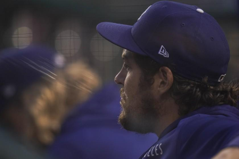 Los Angeles Dodgers starting pitcher Trevor Bauer looks on from the dugout during the fourth inning of a baseball game against the Washington Nationals, Thursday, July 1, 2021, in Washington. (AP Photo/Julio Cortez)