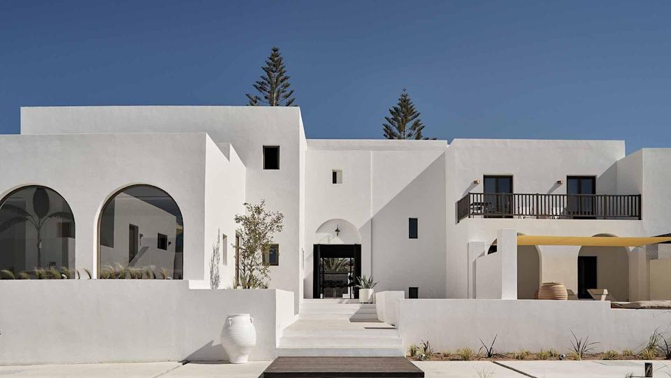 """<p><strong>Set the scene</strong> On the northeast coast of Paros, an easy walk from the sandy coves of Kolymbithres beach, this contemporary opening is attracting a wave of design-driven travelers. It's one of a tiny batch of properties starting to blossom on this lo-fi island, as hoteliers switch their focus from the crowded hot spots of <a href=""""https://www.cntraveler.com/story/for-the-real-santorini-visit-during-off-season?mbid=synd_yahoo_rss"""" rel=""""nofollow noopener"""" target=""""_blank"""" data-ylk=""""slk:Santorini"""" class=""""link rapid-noclick-resp"""">Santorini</a> and Mykonos. Wooden shutters are thrown open in the morning, couples snooze under cream umbrellas, and the silence is punctuated by the whoosh of cocktail shakers.</p> <p><strong>What's the backstory?</strong> There was already an existing hotel on this plot of land when husband and wife owners Antonis and Kalia Eliopoulos bought it in 2018. They employed Athens-based studio Interior Design Laboratorium to rejig the spaces and trim down the number of rooms. Now arched doorways and windows contrast with crisp, geometric lines; there are clusters of earthy oversized urns and cacti in concrete pots dotted about the place; and a peaceful pool.</p> <p><strong>What can we expect in our room?</strong> Porcelain floors are paired with a serene palette and an abstract, embroidered wall hanging by Marrakesh-based lifestyle brand LRNCE. Those on the upper level have a hot tub on the balcony; those on the ground floor come with a palm tree-shaded terrace. The best are the Sun Suites, which have their own private pool.</p> <p><strong>How about the food and drink?</strong> Expect Greek flavors with a twist at Mr E restaurant, which is named after a fictional aristocratic explorer: moussaka croquettes, grilled halloumi cheese with fig marmalade, stuffed courgette with quinoa. For dessert, the tart made with lemons from Chios island is divine. Mojitos are the drink of choice.</p> <p><strong>What's the crowd like?</strong> Grown-u"""