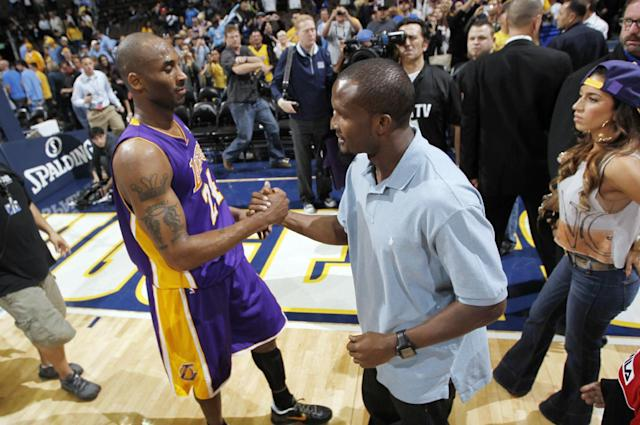 Los Angeles Lakers guard Kobe Bryant, left, is congratulated by Denver Broncos cornerback Champ Bailey after the Lakers' 92-88 victory over the Denver Nuggets in Game 4 of the teams' first-round NBA basketball series in Denver on Sunday, May 6, 2012. (AP Photo/David Zalubowski)