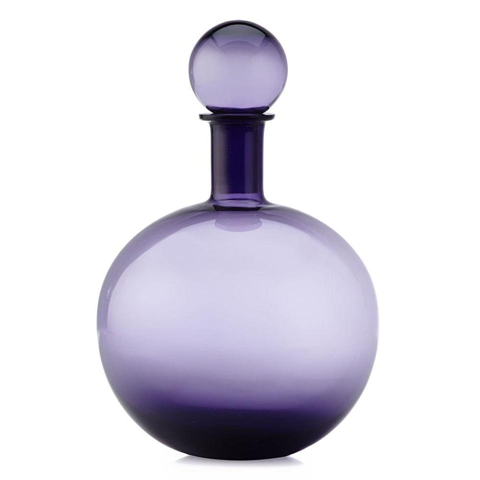 """<p>Jazz up mom's china cabinet with fabulous purple glassware. ($29.95; <a href=""""http://www.zgallerie.com/p-19177-canon-decanter.aspx"""" rel=""""nofollow noopener"""" target=""""_blank"""" data-ylk=""""slk:zgallerie.com"""" class=""""link rapid-noclick-resp"""">zgallerie.com</a>)</p>"""
