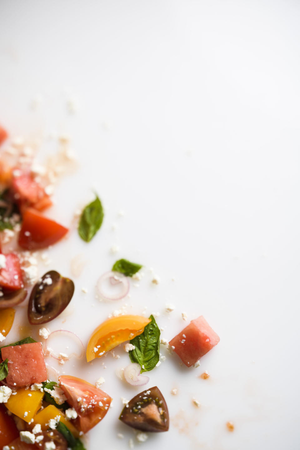 This image released by Milk Street shows a recipe for watermelon salad with tomato, basil and goat cheese. (Milk Street via AP)