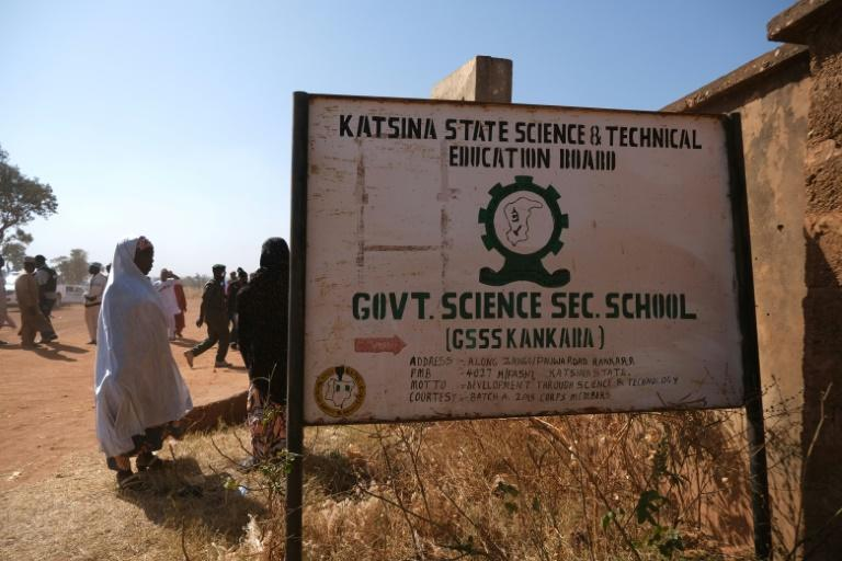 Parents wait outside the Government Science secondary school in Kankara, where hundreds of pupils were abducted