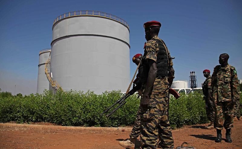 South Sudanese soldiers patrol near an oil refinery in Melut, Upper Nile State, South Sudan (AFP Photo/Hannah Mcneish)