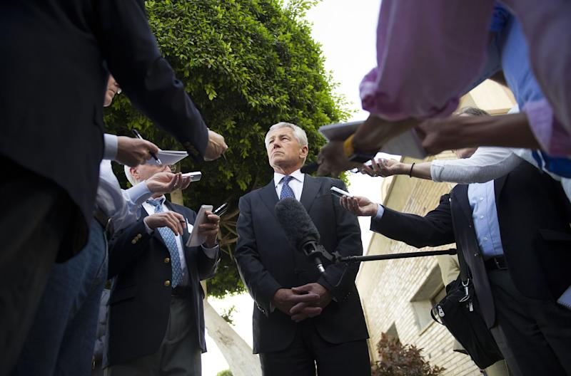 U.S. Secretary of Defense Chuck Hagel speaks with reporters after meeting Egyptian President Mohammed Morsi and Egypt's Defense Minister in Cairo, on Wednesday, April 24, 2013. By including Cairo on his first Mideast tour as defense secretary, Chuck Hagel is highlighting the Obama administration's hope of preserving influence with the Egyptian military as the country struggles with its transition to democracy.(AP Photo/Jim Watson, Pool)