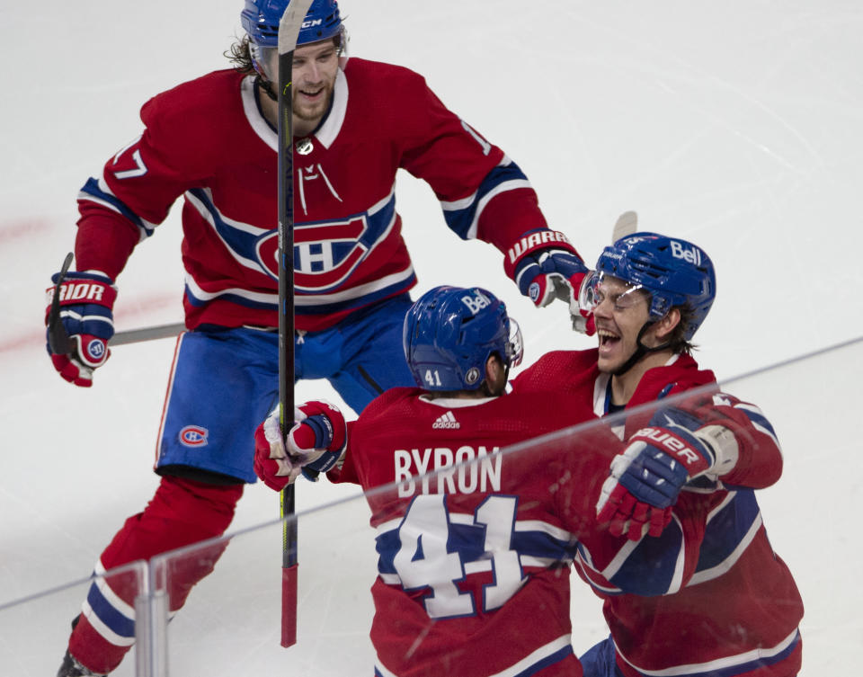 Montreal Canadiens' Jesperi Kotkaniemi, right, celebrates with Paul Byron (41) and Josh Anderson (17) after scoring against the Toronto Maple Leafs in overtime in Game 6 of an NHL hockey Stanley Cup first-round playoff seres Saturday, May 29, 2021, in Montreal. (Ryan Remiorz/The Canadian Press via AP)