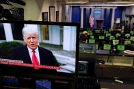 FILE PHOTO: U.S. President Donald Trump is seen making remarks on a television monitor from the White House Briefing Room