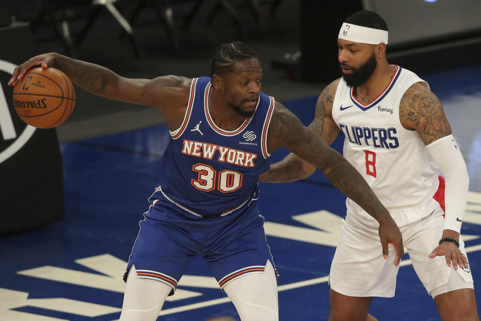 New York Knicks power forward Julius Randle (30) controls the ball against LA Clippers small forward Marcus Morris Sr. (8) during the first half of an NBA basketball game Sunday, Jan. 31, 2021, in New York. (Brad Penner/Pool Photo via AP)
