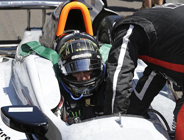 Kurt Busch is strapped into his car before the start of the 98th running of the Indianapolis 500 IndyCar auto race at the Indianapolis Motor Speedway in Indianapolis, Sunday, May 25, 2014. (AP Photo/R Brent Smith)