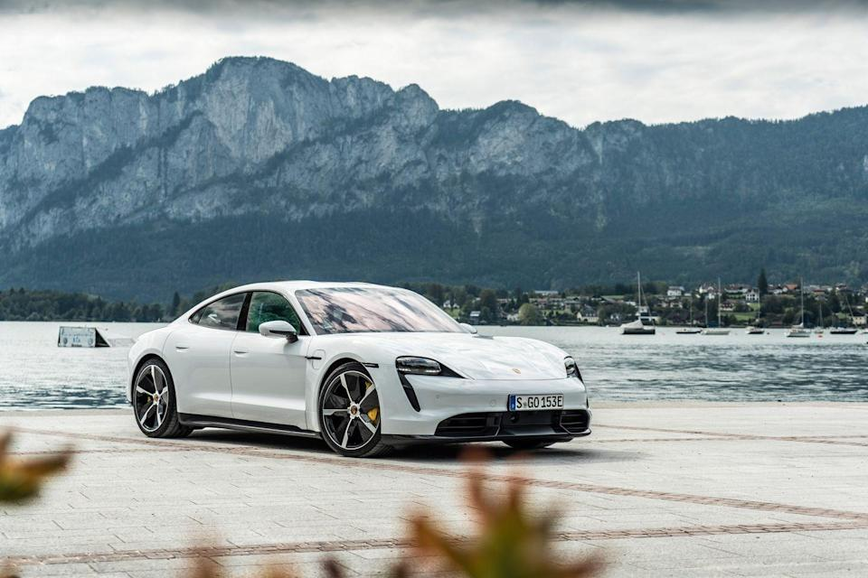 "<p>The <a href=""https://www.caranddriver.com/porsche/taycan"" rel=""nofollow noopener"" target=""_blank"" data-ylk=""slk:2021 Porsche Taycan"" class=""link rapid-noclick-resp"">2021 Porsche Taycan</a> (pronounced <em>tie</em>-kahn) is a truly innovative electric vehicle, showcasing the high-performance potential of the species. As the first production EV with an 800-volt architecture and a <a href=""https://www.caranddriver.com/news/a28903274/porsche-taycan-transmission/"" rel=""nofollow noopener"" target=""_blank"" data-ylk=""slk:multispeed transaxle"" class=""link rapid-noclick-resp"">multispeed transaxle</a>, it sets new benchmarks in charging speeds and acceleration times. In fact, the top-of-the-line 750-hp Turbo S is <a href=""https://www.caranddriver.com/reviews/a30688949/2020-porsche-taycan-turbo-s-testing-acceleration-zero-to-60/"" rel=""nofollow noopener"" target=""_blank"" data-ylk=""slk:among the quickest cars we've ever tested"" class=""link rapid-noclick-resp"">among the quickest cars we've ever tested</a>, even tying hypercars like the <a href=""https://www.caranddriver.com/reviews/a15152105/bugatti-veyron-164-road-test/"" rel=""nofollow noopener"" target=""_blank"" data-ylk=""slk:$1.7 million, 1000-hp Bugatti Veyron 16.4"" class=""link rapid-noclick-resp"">$1.7 million, 1000-hp Bugatti Veyron 16.4</a> to 60 mph in 2.4 seconds. This EV also has stamina, with the ability to make multiple high-speed runs without a significant loss in performance. Sure, the four-door sedan has a much shorter estimated driving range than its primary rival, the <a href=""https://www.caranddriver.com/tesla/model-s"" rel=""nofollow noopener"" target=""_blank"" data-ylk=""slk:Tesla Model S"" class=""link rapid-noclick-resp"">Tesla Model S</a>, and all-wheel drive versions cost at least six figures at present. But the Taycan drives like a <a href=""https://www.caranddriver.com/porsche"" rel=""nofollow noopener"" target=""_blank"" data-ylk=""slk:Porsche"" class=""link rapid-noclick-resp"">Porsche</a> sports car and exhilarates in ways few electric models have done before.</p><p><a class=""link rapid-noclick-resp"" href=""https://www.caranddriver.com/porsche/taycan"" rel=""nofollow noopener"" target=""_blank"" data-ylk=""slk:Review, Pricing, and Specs"">Review, Pricing, and Specs</a></p>"