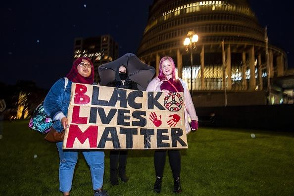 New Zealand protesters hold a vigil against the killing of Minneapolis man George Floyd in a Black Lives Matter protest outside Parliament in Wellington.