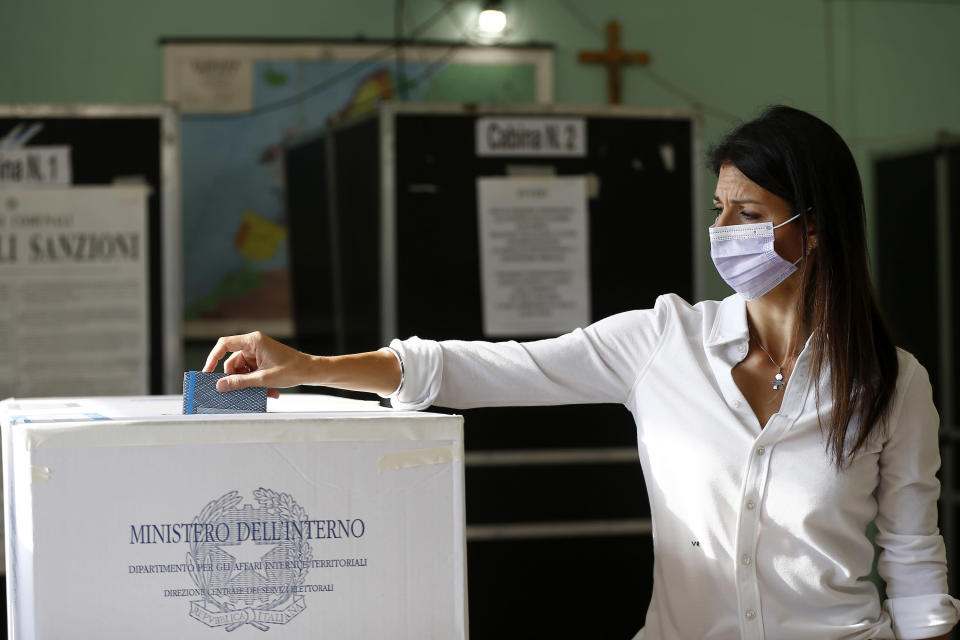 Rome Mayor Virgina Raggi casts her ballot at a polling station, in Rome, Sunday, Oct. 3, 2021. Millions of people in Italy started voting Sunday for new mayors, including in Rome and Milan, in an election widely seen as a test of political alliances before nationwide balloting just over a year away. (Cecilia Fabiano/LaPresse via AP)