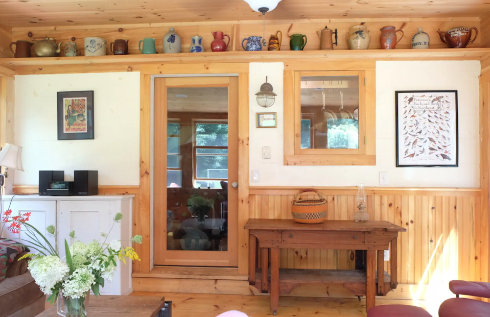 """<h3><a href=""""https://www.airbnb.com/rooms/7132914"""" rel=""""nofollow noopener"""" target=""""_blank"""" data-ylk=""""slk:Cozy Rustic Cabin On 4 Private Acres"""" class=""""link rapid-noclick-resp"""">Cozy Rustic Cabin On 4 Private Acres</a></h3><br>""""The Red House is surrounded by acres of beautiful forest and is close to 12 conservation areas with hiking trails. Minutes to antiquing, Kripalu Yoga Center, Norman Rockwell Museum, The Mount, Tanglewood, skiing, Shakespeare & Co. You'll love my place because of peace, quiet and seclusion. The Red House is good for couples, solo adventurers, and families. Relax by the woodstove, in the sunroom, or explore nearby Spencertown, Chatham, or West Stockbridge. Many ski slopes nearby & a small lake!""""<br><br><strong>Location: </strong>Chatham, New York<br><strong>Sleeps: </strong>7<br><strong>Price Per Night: </strong>$149<br><strong>Price Per Month: </strong>$2,705<span class=""""copyright"""">Photo: Courtesy of Airbnb.</span>"""