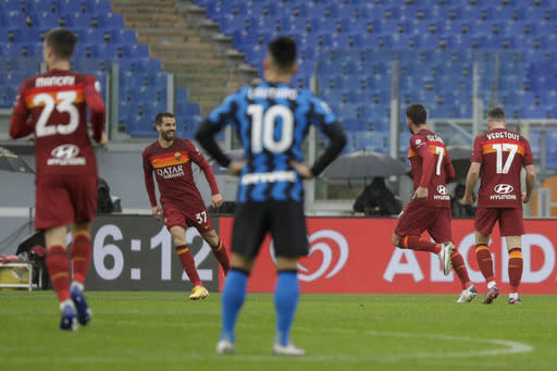 Roma's Lorenzo Pellegrini, second from right, celebrates with his teammates after he scored his side's first goal during a Serie A soccer match between Roma and Inter Milan, at Rome's Olympic Stadium, Sunday, Jan. 10, 2021. (AP Photo/Gregorio Borgia)