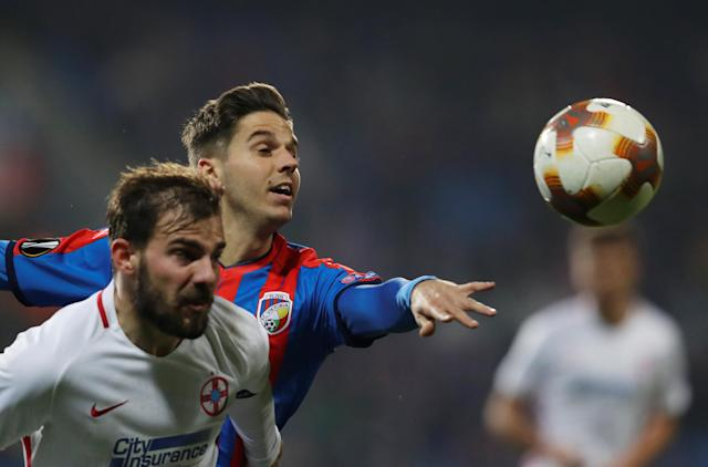 Soccer Football - Europa League - Viktoria Plzen vs Steaua Bucharest - Doosan Arena, Plzen, Czech Republic - November 23, 2017 Steaua Bucharest's Mihai Balasa in action with Viktoria Plzen's Ales Cermak REUTERS/David W Cerny