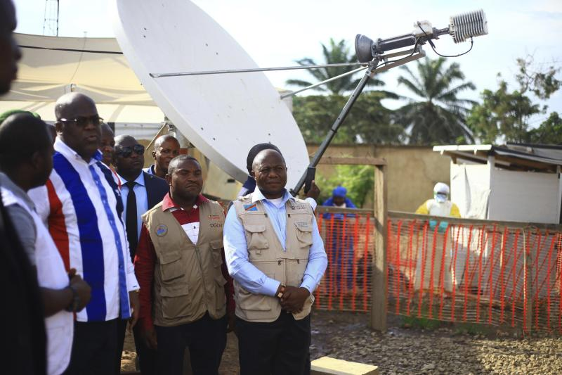 Congo's president, Felix Tshisekedi, left in striped shirt, visits an Ebola treatment center in Beni, Eastern Congo, Tuesday April.16, 2019. Congo's president on Tuesday said he wants to see a deadly Ebola virus outbreak contained in less than three months even as some health experts say it could take twice as long. (AP Photo/Al-hadji Kudra Maliro)
