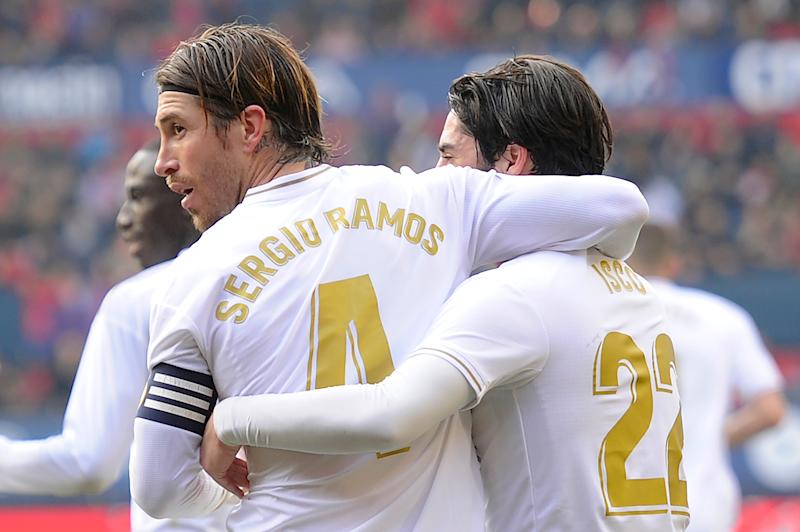 Real Madrid's Spanish defender Sergio Ramos (L) celebrates his goal with teammates during the Spanish league football match between CA Osasuna and Real Madrid CF at El Sadar stadium in Pamplona on February 9, 2020.