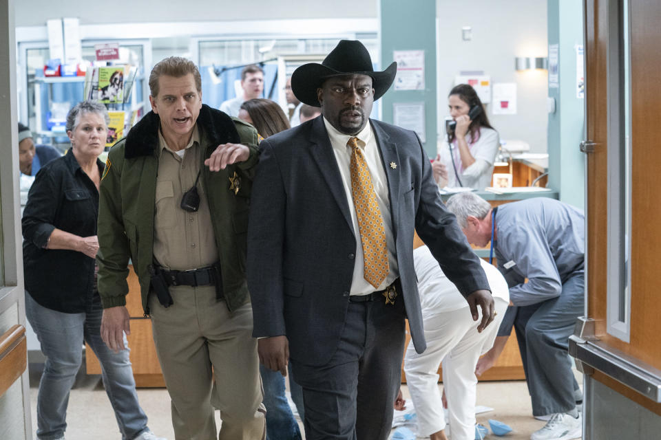 """This image released by Universal Pictures shows Brian F. Durkin, left, and Omar Dorsey in """"Halloween Kills,"""" directed by David Gordon Green. (Ryan Green/Universal Pictures via AP)"""