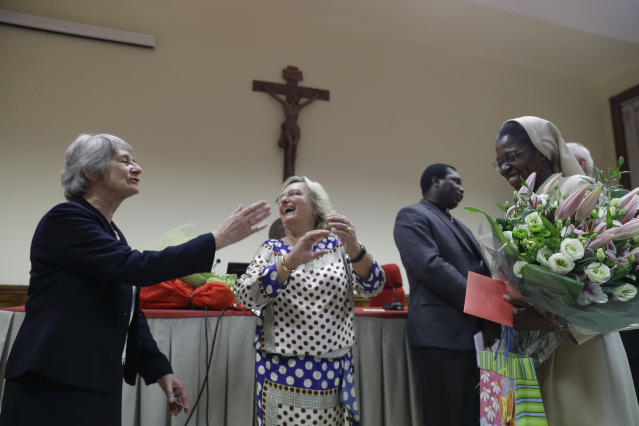 Sister Brenda Dolphin, left, and thesis adviser Karlijn Demasure, center, congratulate Sister Makamatine Lembo after she successfully defended her dissertation on the sexual abuse of religious sisters by priests, at the Pontifical Gregorian University, in Rome, Thursday, Sept. 26, 2019. Togolese Sister Lembo was awarded summa cum laude, and was praised by her examiners for her courage in examining such a taboo subject. (AP Photo/Gregorio Borgia)