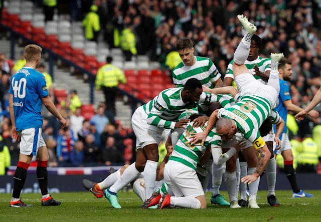 Soccer Football - Scottish Cup Semi Final - Celtic vs Rangers - Hampden Park, Glasgow, Britain - April 15, 2018 Celtic's Tom Rogic celebrates scoring their first goal with teammates REUTERS/Russell Cheyne