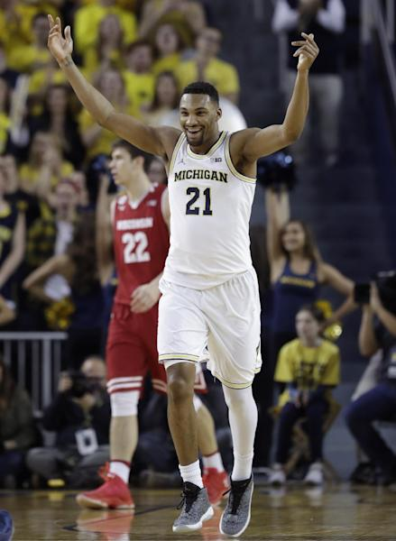 Michigan guard Zak Irvin reacts after a 3-point basket during the first half of the team's NCAA college basketball game against Wisconsin, Thursday, Feb. 16, 2017, in Ann Arbor, Mich. (AP Photo/Carlos Osorio)